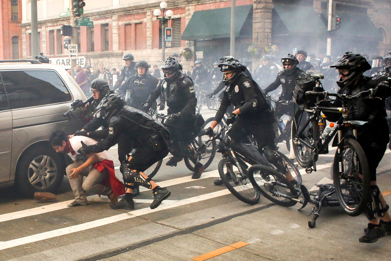 Police officers detain a protester during anti-capitalist protests following May Day marches in Seattle, Washington, U.S. May 1, 2016. REUTERS/David Ryder     TPX IMAGES OF THE DAY      - RTX2CDO2