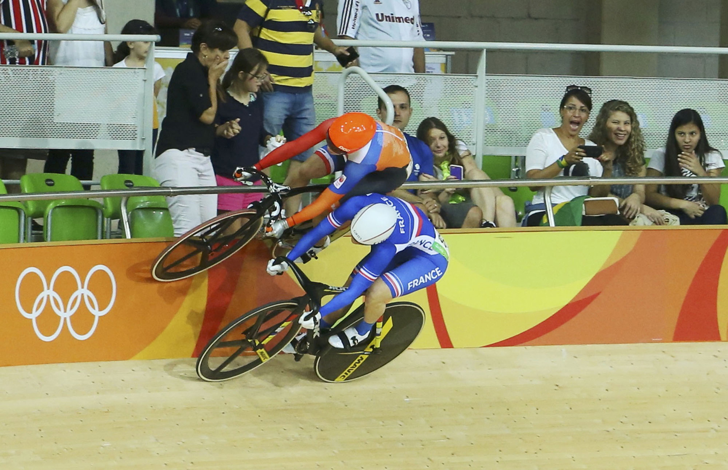 2016 Rio Olympics - Cycling Track - Preliminary - Women's Keirin First Round - Rio Olympic Velodrome - Rio de Janeiro, Brazil - 13/08/2016. Laurine van Riessen (NED) of Netherlands and Virginie Cueff (FRA) of France compete.  REUTERS/Paul Hanna TPX IMAGES OF THE DAY. FOR EDITORIAL USE ONLY. NOT FOR SALE FOR MARKETING OR ADVERTISING CAMPAIGNS.  - RTX2KKY7